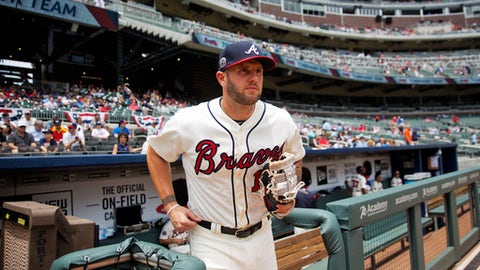 Atlanta Braves' Matt Adams runs onto the field before the start of a baseball game against the Washington Nationals in Atlanta, Sunday, May 21, 2017. Adams joined the Braves Sunday for the first time since being acquired over the weekend from St. Louis, hoping he can help fill the void at first base left by injured star Freddie Freeman. (AP Photo/David Goldman)