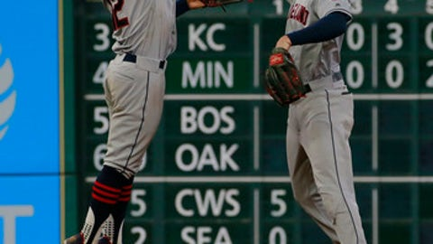 Cleveland Indians' shortstop Francisco Lindor and center fielder Bradley Zimmer celebrate their 8-6 win over the Houston Astros' at the end of a baseball game, Sunday, May 21, 2017 in Houston. (AP Photo/Richard Carson)