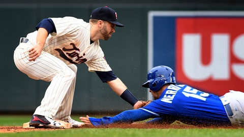 Minnesota Twins second baseman Brian Dozier, left, tags out Kansas City Royals' Whit Merrifield, right, in the eighth inning during the first game of a baseball doubleheader Sunday, May 21, 2017, in Minneapolis.(AP Photo/Tom Olmscheid)