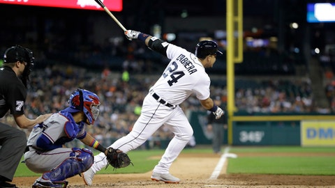 Detroit Tigers' Miguel Cabrera (24) connects for an RBI-single during the second inning of a baseball game against the Texas Rangers, Sunday, May 21, 2017, in Detroit. (AP Photo/Carlos Osorio)