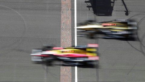 James Hinchcliffe, top, of Canada,and Jack Harvey, of England, drive across the Yard of Bricks during practice for the Indianapolis 500 IndyCar auto race at Indianapolis Motor Speedway, Monday, May 22, 2017 in Indianapolis. (AP Photo/Darron Cummings)