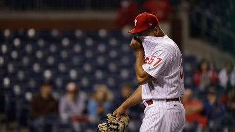 Philadelphia Phillies relief pitcher Luis Garcia wipes his face as he walks to the dugout after the ninth inning of a baseball game against the Colorado Rockies, Monday, May 22, 2017, in Philadelphia. Colorado won 8-1. (AP Photo/Matt Slocum)