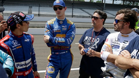 FILE - In this May 18, 2017, file photo, drivers Takuma Sato, of Japan, left, Alexander Rossi, second from left, and Fernando Alonso, of Spain, right, talk with car owner Michael Andretti, second from right, during a practice session for the Indianapolis 500 IndyCar auto race at Indianapolis Motor Speedway in Indianapolis. Michael Andretti needed some assurances before running six cars in this year's Indianapolis 500.  He also needed some help. But aside from finding extra crew members and sponsorship, the biggest challenge of this week may be communication.  (AP Photo/Michael Conroy, File)