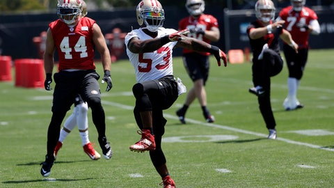 San Francisco 49ers linebacker NaVorro Bowman (53) and teammates stretch during the team's organized team activity at its NFL football training facility Tuesday, May 23, 2017, in Santa Clara, Calif. (AP Photo/Marcio Jose Sanchez)