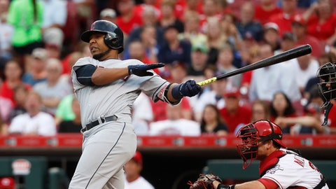 Cleveland Indians' Edwin Encarnacion hits a go-ahead two-run home run off Cincinnati Reds starting pitcher Amir Garrett in the third inning of a baseball game, Tuesday, May 23, 2017, in Cincinnati. (AP Photo/John Minchillo)