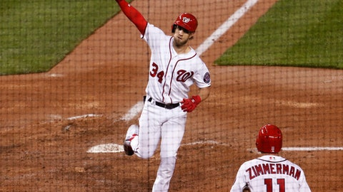 Washington Nationals Bryce Harper (34) waves to the crowd after hitting a home run during the fourth inning of a baseball game against the Seattle Mariners in Washington, Tuesday, May 23, 2017. Nationals Ryan Zimmerman (11) waits on deck. (AP Photo/Manuel Balce Ceneta)