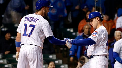 Chicago Cubs' Kris Bryant (17) celebrates with Anthony Rizzo, after the pair scored on Rizzo's two-run home run off San Francisco Giants starting pitcher Johnny Cueto, during the fourth inning of a baseball game Tuesday, May 23, 2017, in Chicago. (AP Photo/Charles Rex Arbogast)