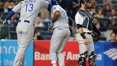 Kansas City Royals designated hitter Salvador Perez (13) celebrates with Royals' Jorge Bonifacio (38) after scoring on Bonifacio's two-run, home run during the seventh inning of a baseball game against the New York Yankees in New York, Tuesday, May 23, 2017.New York Yankees catcher Austin Romine is at right. (AP Photo/Kathy Willens)