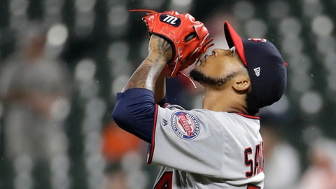 Minnesota Twins starting pitcher Ervin Santana kisses his glove after closing out a baseball game against the Baltimore Orioles in Baltimore, Tuesday, May 23, 2017. Santana pitched nine complete innings in Minnesota's 2-0 win. (AP Photo/Patrick Semansky)