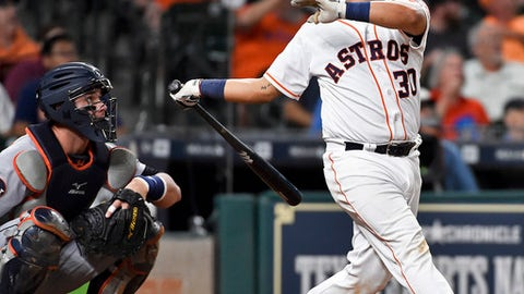 Houston Astros' Juan Centeno watches his solo home run off Detroit Tigers starting pitcher Jordan Zimmermann during the fourth inning of a baseball game, Tuesday, May 23, 2017, in Houston. (AP Photo/Eric Christian Smith)