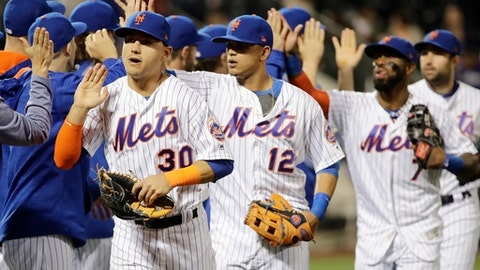 New York Mets' Michael Conforto (30) and Juan Lagares (12) celebrate with teammates after a baseball game against the San Diego Padres Tuesday, May 23, 2017, in New York. The Mets won 9-3. (AP Photo/Frank Franklin II)