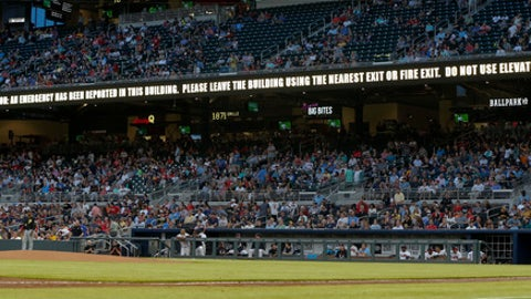 A message warning flashes on a sign board during the first inning of a baseball game between the Pittsburgh Pirates and Atlanta Braves, Tuesday, May 23, 2017, in Atlanta. The game continued uninterrupted. (AP Photo/John Bazemore)
