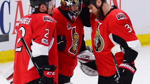 Ottawa Senators defenseman Dion Phaneuf (2), Senators goalie Craig Anderson (41) and Ottawa Senators defenseman Marc Methot (3) celebrate after defeating the Pittsburgh Penguins in game six of the Eastern Conference final in the NHL Stanley Cup hockey playoffs in Ottawa on Tuesday, May 23, 2017. (Sean Kilpatrick/The Canadian Press via AP)