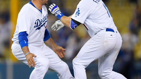 Los Angeles Dodgers' Logan Forsythe, right, celebrates with Adrian Gonzalez after hitting an RBI double in the 13th inning of a baseball game against the St. Louis Cardinals, Tuesday, May 23, 2017, in Los Angeles. The Dodgers won 2-1. (AP Photo/Mark J. Terrill)