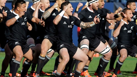 FILE - In this Nov. 1, 2014 file photo, New Zealand All Blacks players perform the traditional haka dance before play against the USA Eagles during the International Test Rugby Match in Chicago. New Zealand's famed All Blacks rugby team has been awarded Spain's Princess of Asturias prize on Wednesday May 24, 2017 for sports in recognition of its extraordinary success and for representing the values of solidarity and racial and cultural integration.(AP Photo/Nam Y. Huh, File)