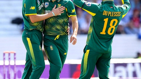 South Africa's Wayne Parnell, centre, celebrates taking the wicket of England's Jason Roy,  during the One Day International at Headingley, Leeds, England Wednesday May 24, 2017. (Martin Rickett/PA via AP)