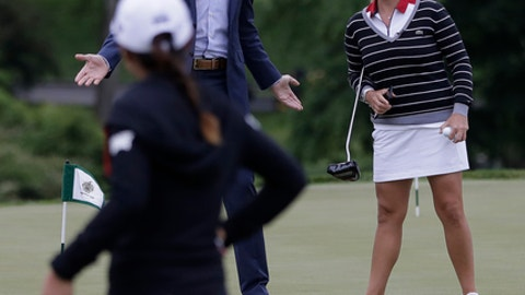 Eric Trump, top left, talks to professional golfers Cristie Kerr, top right, and Lydia Ko prior to the start of a news conference previewing the U.S. Women's Open Championship at Trump National Golf Club, Wednesday, May 24, 2017, in Bedminster, N.J. (AP Photo/Julio Cortez)