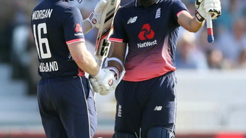 England's Moeen Ali, right, celebrates making a half century with teammate Eoin Morgan during the one day international against South Africa at Headingley, Leeds, England, Wednesday May 24, 2017. (Martin Rickett/PA via AP)