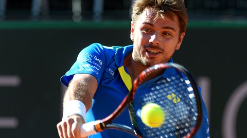 "Switzerland's tennis player Stanislas ""Stan"" Wawrinka, returns a ball to Brazilian Rogerio Dutra Silva,  during their second round match of the Geneva Open tennis tournament in Geneva, Switzerland, Wednesday, May 24, 2017. (Martial Trezzini/Keystone via AP)"