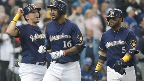 Milwaukee Brewers' Domingo Santana is congratulated at home after hitting a three-run home run during the sixth inning of a baseball game against the Toronto Blue Jays Wednesday, May 24, 2017, in Milwaukee. (AP Photo/Morry Gash)