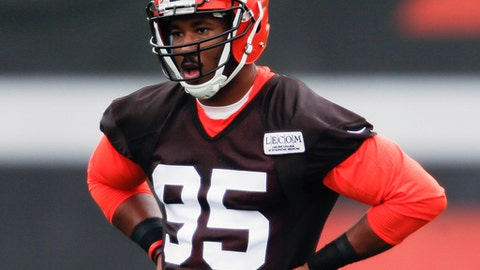 """FILE - In this May 12, 2017, file photo, Cleveland Browns' Myles Garrett listens to his coaches during NFL football rookie minicamp, in Berea, Ohio. Garrett, the No. 1 overall draft pick, is not practicing because of an unspecified injury. Garrett was not on the field Wednesday, May 24, 2017, and after the workout he said the team is being """"cautious about a little nick."""" (AP Photo/Ron Schwane, File)"""