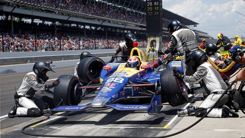 FILE - In this May 29, 2016, file photo, the car driven by Alexander Rossi is serviced during a pit stop in the 100th running of the Indianapolis 500 auto race at Indianapolis Motor Speedway in Indianapolis. Putting together the right pit crew can make all the difference on race day. Just ask defending Indianapolis 500 champion Alexander Rossi, who overcame some early race struggles last year and wound up relying on those same guys to help him reach victory lane. (AP Photo/Rob Baker, File)