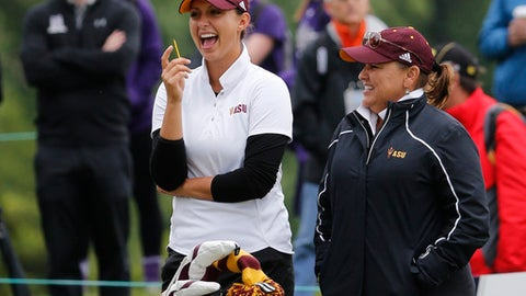 Arizona State's Monica Vaughn, left, laughs with coach Missy Farr-Kaye during the final round of the NCAA Division I Women's Golf Championships against Northwestern at Rich Harvest Farms, Wednesday, May 24, 2017, in Sugar Grove, Ill. Earlier in the week Vaughn became the 2017 NCAA Women's individual champion. (AP Photo/Charles Rex Arbogast)