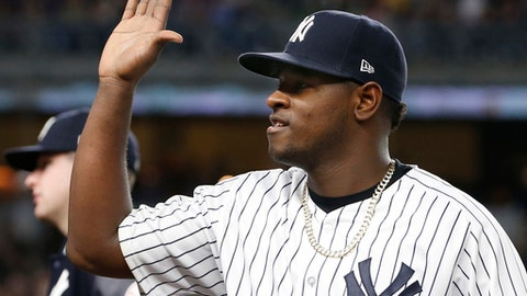 New York Yankees starting pitcher Luis Severino reacts as teammates come out to greet him after he pitched eight innings in the Yankees 3-0 shutout of the Kansas City Royals in a baseball game at Yankee Stadium in New York, Wednesday, May 24, 2017. (AP Photo/Kathy Willens)