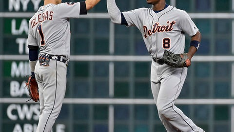 Detroit Tigers' Jose Iglesias, left, and Justin Upton celebrate the team's 6-3 win over the Houston Astros in a baseball game, Wednesday, May 24, 2017, in Houston. (AP Photo/Eric Christian Smith)