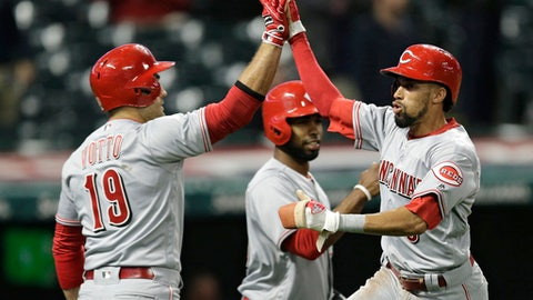 Cincinnati Reds' Billy Hamilton is congratulated by Joey Votto after Hamilton scored the game-winning run in the ninth inning of an interleague baseball game against the Cleveland Indians, Wednesday, May 24, 2017, in Cleveland. Hamilton scored on t Zack Cozart's single. The Reds won 4-3. (AP Photo/Tony Dejak)