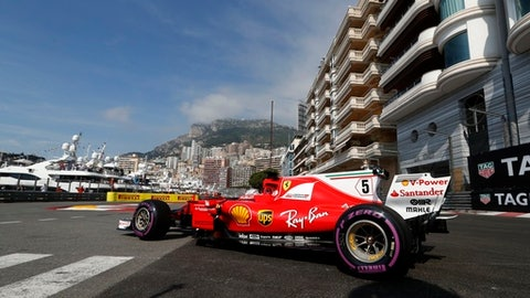 Ferrari driver Sebastian Vettel of Germany steers his car during the first free practice at the Formula One Grand Prix at the Monaco racetrack in Monaco, Thursday, May 25, 2017. The Formula one race will be held on Sunday. (AP Photo/Frank Augstein)