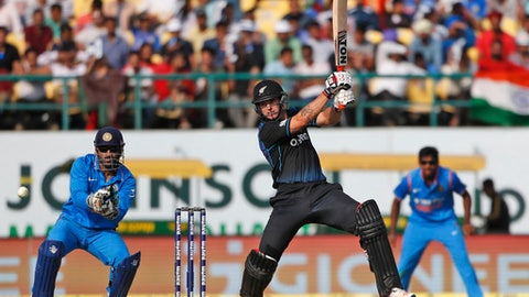 FILE - A Sunday, Oct. 16, 2016 photo from files of New Zealand's Doug Bracewell batting during the first one-day international cricket match against India in Dharmsala, India. Black Caps cricketer Doug Bracewell has pleaded guilty to a third charge of driving under the influence of alcohol and told a New Zealand court he was hurrying to console his partner over a dead parrot. (AP Photo/Tsering Topgyal, File)
