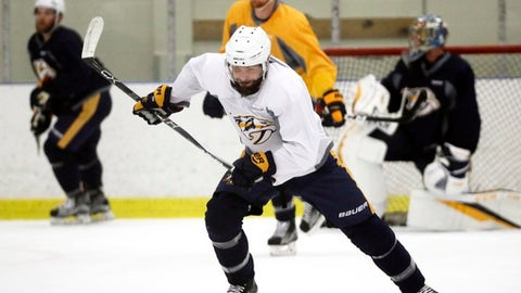 """Nashville Predators center Mike Fisher, front, skates during practice at the team's NHL hockey facility Thursday, May 25, 2017, in Nashville, Tenn. Fisher did not play in the final two games of the Western Conference finals against the Anaheim Ducks after suffering a head injury in Game 4. Predators general manager David Poile said Wednesday there's """"a real good chance"""" Fisher could return in Game 1 of the Stanley Cup Finals on May 29. (AP Photo/Mark Humphrey)"""