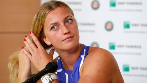 Petra Kvitova of the Czech Republic adjusts her hair during a press conference at the Roland Garros stadium, Friday, May 26, 2017 in Paris. Kvitova has confirmed she is making her comeback at the French Open, less than six months after being attacked by a knife-wielding intruder. Kvitova has missed all season so far while recovering from surgery on her left, racket-holding hand in December. (AP Photo/Christophe Ena)