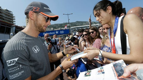 McLaren driver Jenson Button of Britain signs autographs during the off-day of the Formula One Grand Prix at the Monaco racetrack in Monaco, Friday, May 26, 2017. The Formula 1 Grand Prix of Monaco will take place on Sunday May 28.(AP Photo/Claude Paris)
