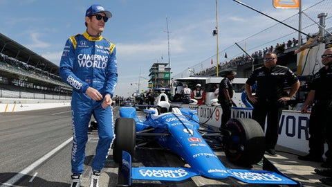 Scott Dixon, of New Zealand, walks to his pit box during the final practice session for the Indianapolis 500 IndyCar auto race at Indianapolis Motor Speedway, Friday, May 26, 2017 in Indianapolis. (AP Photo/Darron Cummings)