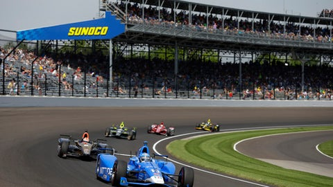 Tony Kanaan, of Brazil, drives through the first turn during the final practice session for the Indianapolis 500 IndyCar auto race at Indianapolis Motor Speedway, Friday, May 26, 2017 in Indianapolis. (AP Photo/Michael Conroy)