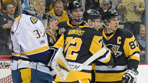 FILE - In this Jan. 31, 2017, file photo, Pittsburgh Penguins right wing Patric Hornqvist (72) is congratulated by center Sidney Crosby (87) after scoring a goal as Nashville Predators goalie Pekka Rinne (35) waits for play to resume during the second period of an NHL hockey game, in Pittsburgh. A shot at a second straight Stanley Cup beckons for the Penguins. But the group that escaped against Ottawa may not be the dynamo that stormed to a title last year. That doesn't mean Pittsburgh is any less dangerous. (AP Photo/Fred Vuich, File)