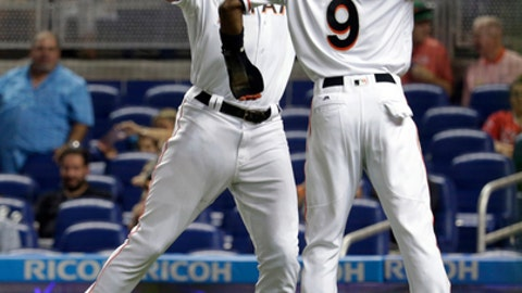 Miami Marlins' Giancarlo Stanton, left, celebrates with Dee Gordon (9) after hitting a two-run home run during the first inning of an interleague baseball game against the Los Angeles Angels, Friday, May 26, 2017, in Miami. (AP Photo/Lynne Sladky)