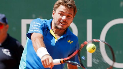 "Stanislas ""Stan"" Wawrinka of Switzerland returns a ball to Mischa Zverev of Germany during their final match at the Geneva Open tennis tournament in Geneva, Switzerland, Saturday, May 27, 2017. (Salvatore Di Nolfi/Keystone via AP)"