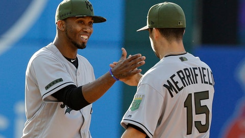 Kansas City Royals' Alcides Escobar, left, and Whit Merrifield celebrate after the Royals defeated the Cleveland Indians in a baseball game, Saturday, May 27, 2017, in Cleveland. (AP Photo/Tony Dejak)