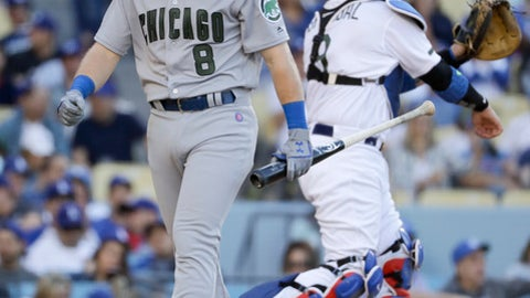 Chicago Cubs' Ian Happ walks off after striking out against the Los Angeles Dodgers during the seventh inning of a baseball game in Los Angeles, Saturday, May 27, 2017. (AP Photo/Chris Carlson)