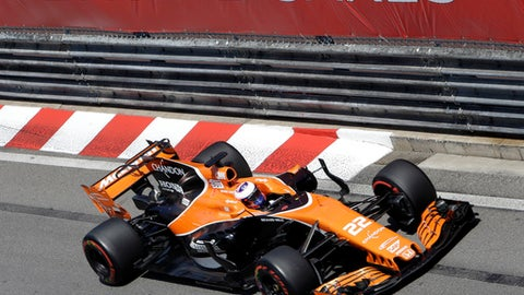 McLaren driver Jenson Button of Britain steers his car during the Formula One Grand Prix at the Monaco racetrack in Monaco, Sunday, May 28, 2017. (AP Photo/Claude Paris)