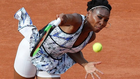 Venus Williams of the U.S. serves against China's Qiang Wang during their first round match of the French Open tennis tournament at the Roland Garros stadium, in Paris, France. Sunday, May 28, 2017. (AP Photo/Michel Euler)
