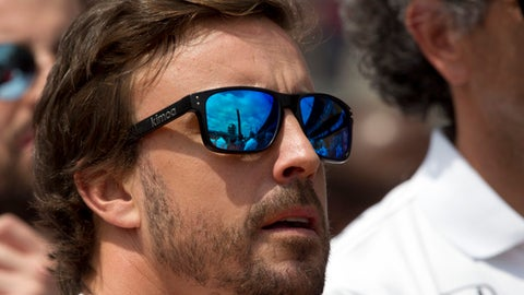 Fernando Alonso, of Spain, waits nears his car for the start of the Indianapolis 500 auto race at Indianapolis Motor Speedway, Sunday, May 28, 2017 in Indianapolis. (AP Photo/Michael Conroy)