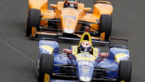 Alexander Rossi leads Fernando Alonso, of Spain, into the first turn during the running of the Indianapolis 500 auto race at Indianapolis Motor Speedway, Sunday, May 28, 2017, in Indianapolis. (AP Photo/R Brent Smith)