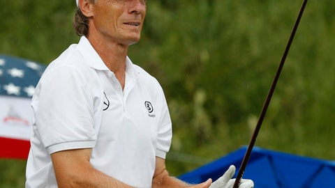 Bernhard Langer, of Germany, watches his tee shot on the second hole during the final round of the Senior PGA Golf Championship at the Trump National golf club in Sterling, Va., Sunday, May 28, 2017. (AP Photo/Steve Helber)