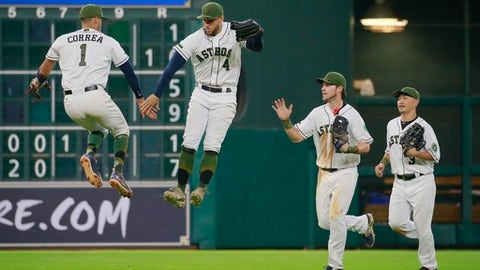 Houston Astros' Carlos Correa and George Springer celebrate their win over the Baltimore Orioles with teammates Josh Reddick and Norichika Aoki at the end of a baseball game Sunday, May 28, 2017, in Houston. (AP Photo/Richard Carson)