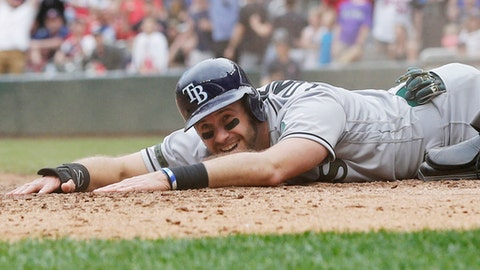 Tampa Bay Rays' Evan Longoria enjoys a laugh as he scores to tie the baseball game on a single by Steven Souza, Jr. in the ninth inning of a baseball game Sunday, May 28, 2017 in Minneapolis. (AP Photo/Jim Mone)