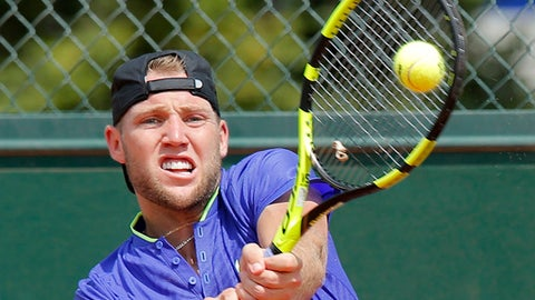 Jack Sock of the U.S. returns the ball to Jiri Vesely of the Czech Republic during their first round match of the French Open tennis tournament at the Roland Garros stadium, Monday, May 29, 2017 in Paris. (AP Photo/Michel Euler)